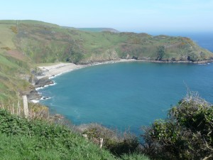A view of Lantic Bay showing a white sandy beach in a cove.