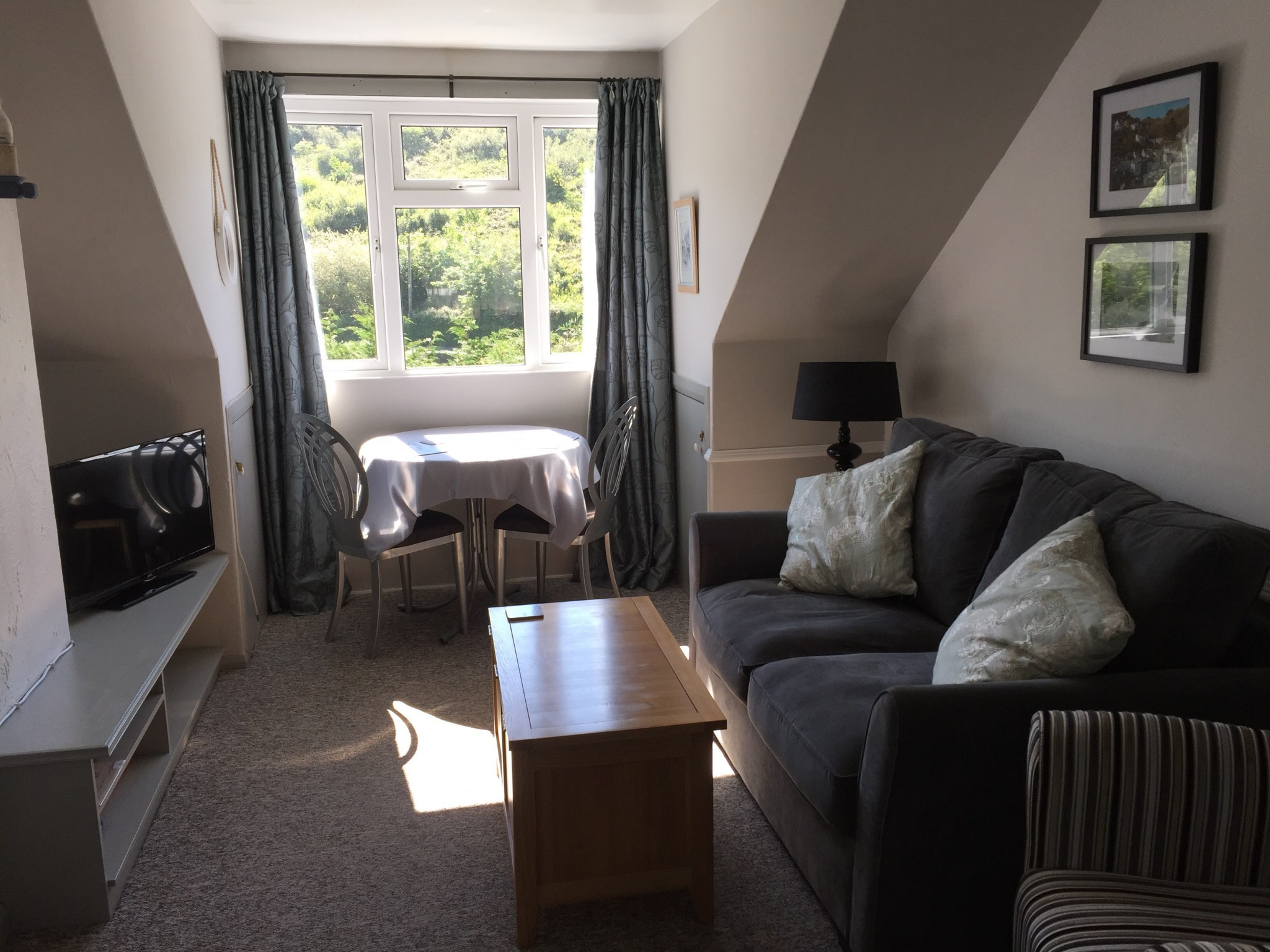 A dining area with views of Polperro valley.
